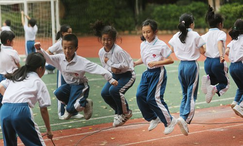 Students in Foshan, Guangdong Province, play rope skipping after class on Thursday. Photo: VCG