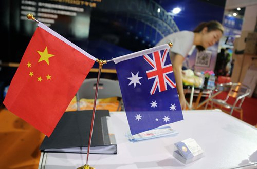 Chinese and Australian flags displayed at an investment fair in Shanghai Photo: IC