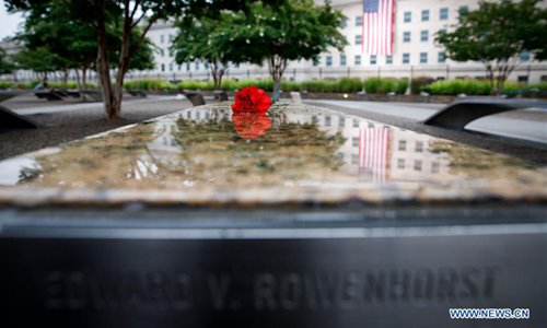 A flower is placed at the National 9/11 Pentagon Memorial during a ceremony marking the 17th anniversary of the Sept. 11 attacks in Arlington, Virginia, the United States, on Sept. 11, 2018. Memorials were held across the United States on Tuesday to mark the 17th anniversary of the Sept. 11 attacks. (Xinhua/Ting Shen)