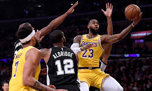 2ee661243c8 LeBron James of the Los Angeles Lakers attempts a layup against the San  Antonio Spurs on Monday in Los Angeles. Photo  VCG