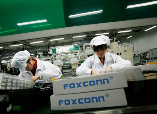 Employees work at a Foxconn factory in the township of Longhua, South China's Guangdong Province File photo: VCG