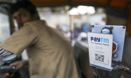 An ad for the PayTM online payment system on an auto rickshaw in Bengaluru, India. Photo: VCG
