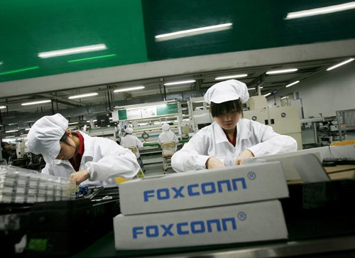 Employees work at a Foxconn factory in the township of Longhua in Shenzhen, South China's Guangdong Province. Photo: VCG