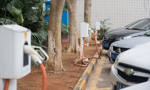 Electric cars park near charging stations in Haikou, South China's Hainan Province. The tropical province issued a plan on Tuesday to boost the development of new-energy cars, vowing to ban the sales of fuel-based cars by 2030. It aims to upgrade its public service vehicle fleet with those powered by clean energy by 2020. Photo: VCG