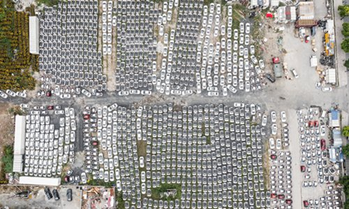 More than 5,000 shared cars left idle beside the Qiantang River