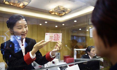 Trade war may help yuan's globalization