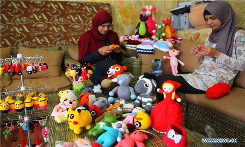 Palestinian sisters sell wool dolls online to support family
