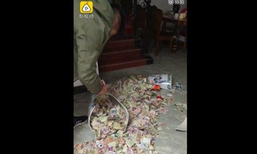 Husband's secret money stash spills on the floor