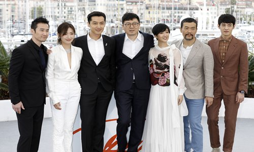 Hu Ge (third from left), Diao Yinan (center), Kwai Lun-mei (third from right) at the 'Nan Fang Che Zhan De Ju Hui /The Wild Goose Lake' premiere during the 72nd Cannes Film Festival at the Palais des Festivals on Sunday in Cannes, France. Photo: IC