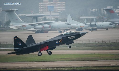 A Chinese FC-31 stealth fighter has its test flight ahead of the 10th China International Aviation and Aerospace Exhibition in Zhuhai, South China's Guangdong Province, Nov 10, 2014. Photo: Xinhua