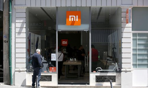 People visit a newly-opened Mi store in Porto, Portugal, on June 15, 2019. Chinese technology company Xiaomi opened its first official Mi store in Porto on June 1. (Photo: Xinhua)