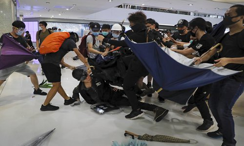 HK rioters assault police, shock public