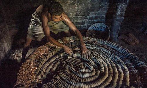 "Potters make ""Bhar"" in Kolkata, India"