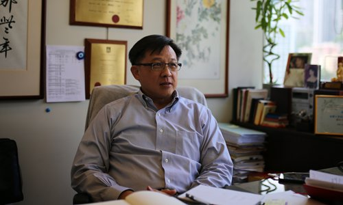 Lawmaker claims Hong Kong rioters set office on fire
