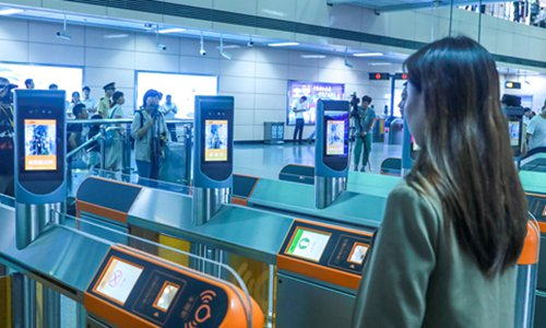 Citizens in Guangzhou, South China's Guangdong Province have their faces scanned to enter the city's metro service on Monday at two pilot stations equipped with facial recognition systems. Passengers need to register their personal information in advance on the metro operator's app. Photo: VCG