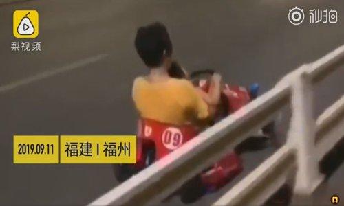 Woman, child go-kart on highway