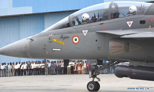Indian defense minister flies light combat aircraft in Bangalore