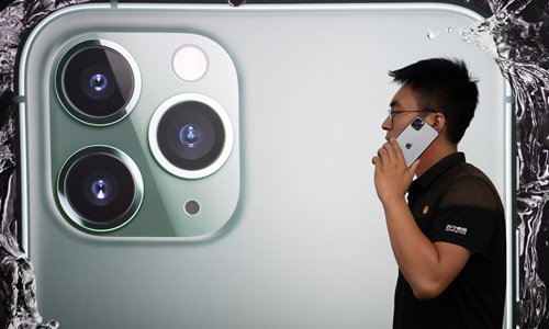 A man tries the new iPhone 11 at an Apple store in Taiyuan, North China's Shanxi Province on Friday. Photo: IC