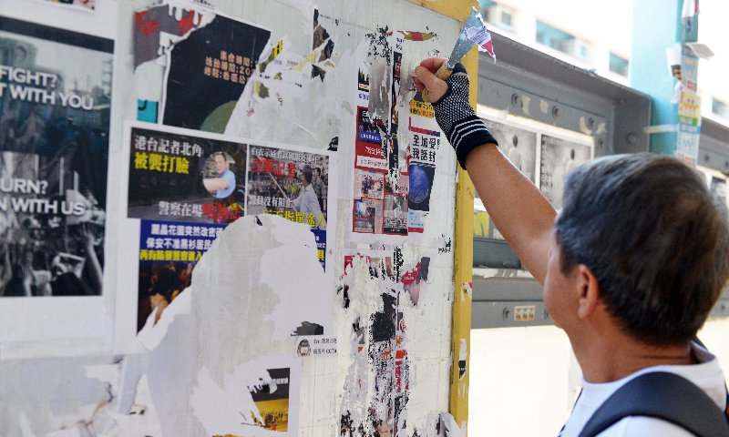 HK legislator launches campaign to clean city's streets; residents join in