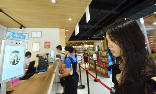 A customer uses a facial-payment system supported by Alipay technology at a bookstore in Hangzhou, East China's Zhejiang Province, on July 17, 2019. Photo: IC
