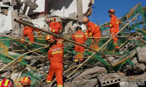 4 rescued, 2 trapped in NE China building collapse