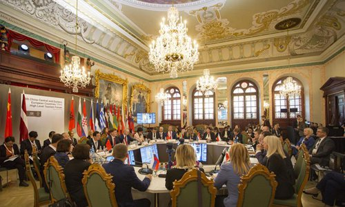 Participants attend the 5th China-Central and Eastern European Countries (CEEC) 17+1 High-level Tourism Forum in Riga, Latvia, on Oct. 23, 2019. (Photo by Edijs Palens/Xinhua)