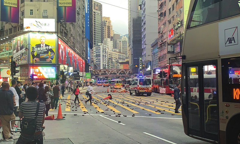 Petrified HK parents rush to send kids to safety as rioters wreak havoc on school