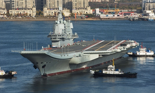 China's homemade carrier sails through Taiwan Straits, commissioning imminent
