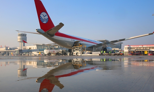 A cargo aircraft of Sichuan Airlines arrives at Nantong Xingdong International Airport, East China's Jiangsu Province, from Mumbai, India, on Monday. The plane carries 33.6 tons of goods to Osaka, Japan. It represents the airport's first global cargo air route connecting Mumbai, Nantong and Osaka. The first shipment includes textile products, suitcases, toys and electronic components. Photo: VCG