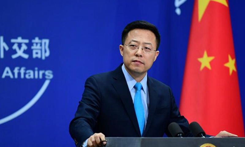 US should invite WHO experts to trace the origin of COVID-19 in their  country: Chinese FM - Global Times
