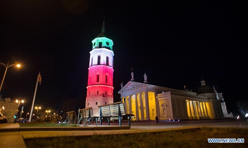 Buildings illuminated in colors of Italian national flag in sign of solidarity in Lithuania