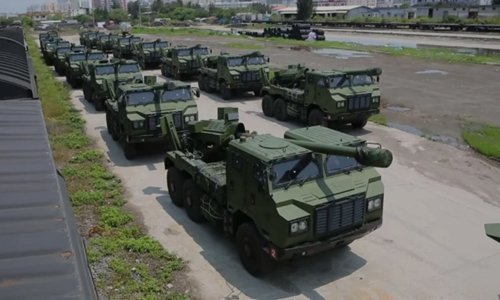 More than a dozen PCL-181 vehicle-mounted howitzers are being delivered to the Chinese People's Liberation Army Eastern Theater Command. Photo: Screenshot from China Central Television