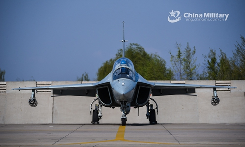 A JL-10 fighter trainer aircraft attached to a regiment under the PLA Naval Aviation University taxies on the flightline in preparation to take off for a live-fire flight training course near the Bohai Bay area in late April, 2020. (eng.chinamil.com.cn/Photo by Xu Yinglong)