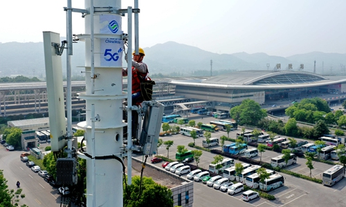 A China Mobile employee adjusts and tests 5G base station equipment at Tongling Railway Station in East China's Anhui Province on April 27. Photo: cnsphoto