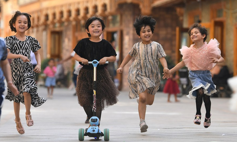 Children have fun in Dove Lane in the old town Tuancheng of Hotan City, northwest China's Xinjiang Uygur Autonomous Region, May 27, 2020.Photo:Xinhua