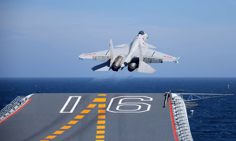 A J-15 carrier-borne fighter jet takes off from the flight deck of the aircraft carrier <em>Liaoning</em> during a maritime training exercise on July 1, 2017. The Chinese aircraft carrier <em>Liaoning</em> and its carrier strike group carried out realistic training in an undisclosed sea area on July 1, 2017. (eng.chinamil.com.cn/Photo by Li Tang)