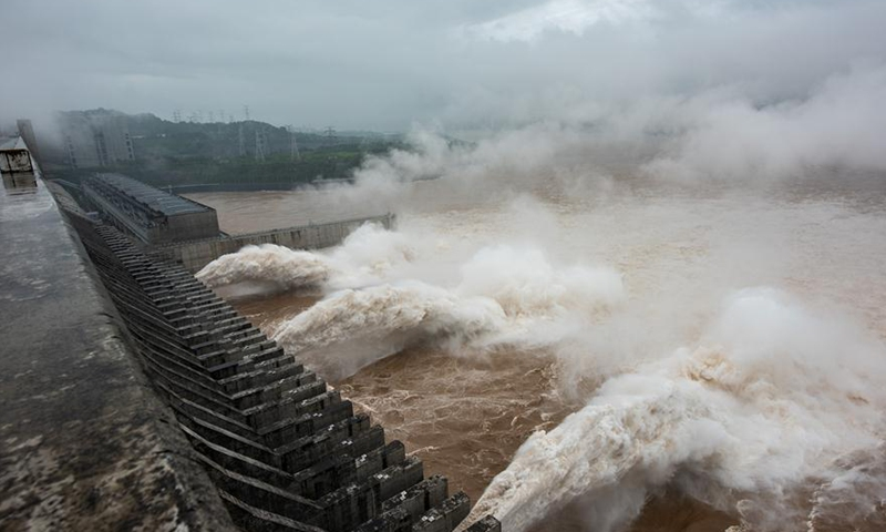 Photo taken on July 18, 2020 shows the Three Gorges Dam opening the floodgates to discharge the floodwater on the Yangtze River in central China's Hubei Province. The Three Gorges reservoir in central China's Hubei Province has seen the second flood along the Yangtze River in 2020, the largest one arriving at the reservoir so far this year. At 8 a.m. on Saturday, the inbound flow of water reached 61,000 cubic meters per second while the outbound flow was 33,000 cubic meters per second, with 45 percent of floodwater withheld in the reservoir, according to the China Three Gorges Corporation.Photo:Xinhua