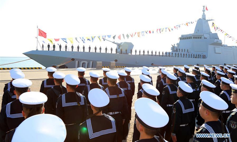 Photo taken on Jan. 12, 2020 shows the ceremony of the commissioning of the Nanchang, China's first Type 055 guided-missile destroyer, in the port city of Qingdao, east China's Shandong Province. The commission of Nanchang marks the Navy's leap from the third generation to the fourth generation of destroyers, according to a statement from the Navy. (Photo by Li Tang/Xinhua)