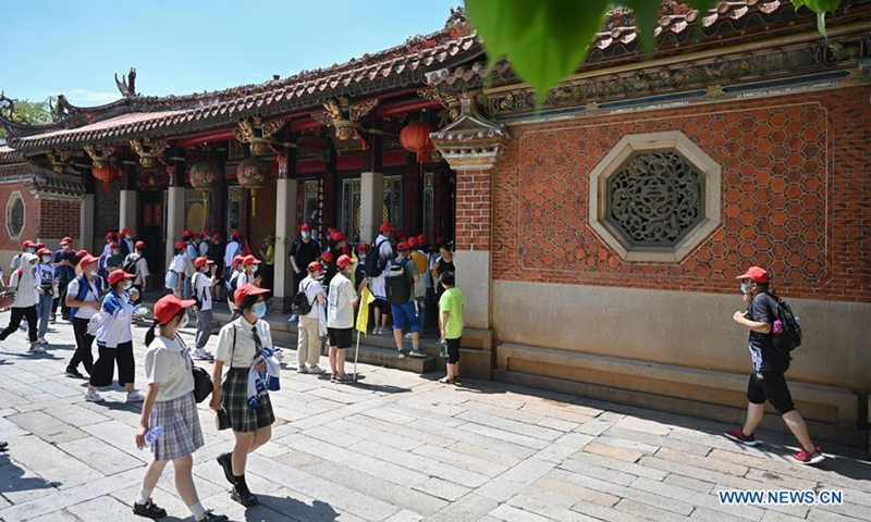 Tourists visit Wudianshi block, a scenic spot which has gone viral on the internet, in Quanzhou, southeast China's Fujian Province, July 29, 2020. During summer holiday, tourism in Quanzhou has been boosted by night economy and famous scenic spots on the internet as young people flock here. (Xinhua/Song Weiwei)