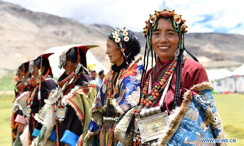 Women wearing Burang clothes are seen in Burang County of Ali, southwest China's Tibet Autonomous Region, July 28, 2020. Burang clothes, decorated with gold, silver, pearls and other jewels, has a history of more than 1,000 years. (Xinhua/Zhan Yan)