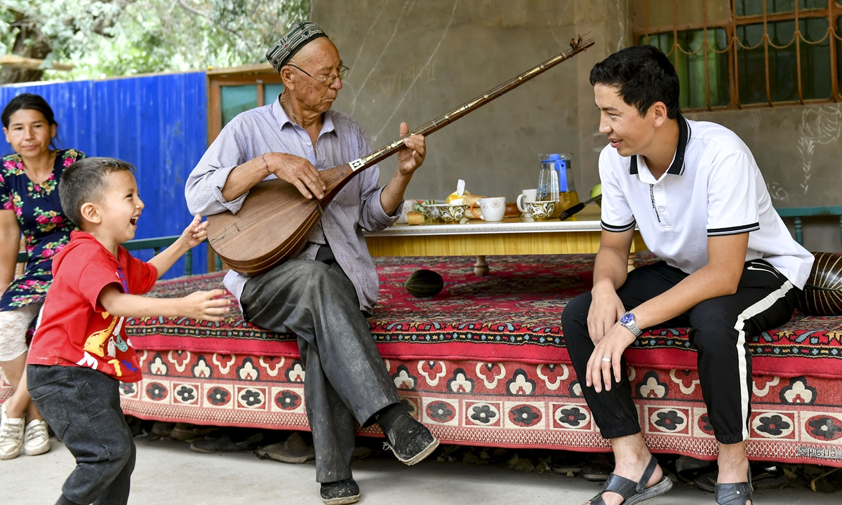 A Uygur man plays a traditional instrument Photo: Xinhua