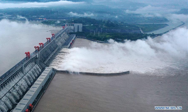 Aerial photo taken on Aug. 20, 2020 shows floodwater gushing out from the Three Gorges Dam in central China's Hubei Province. The Three Gorges Reservoir is undergoing the test of a record high inbound water flow on Wednesday since the reservoir was constructed in 2003. The inbound flow reached 75,000 cubic meters per second around 8 a.m. as the peak floodwater of Yangtze River's fifth flood of the year arrived at the dam. Photo:Xinhua