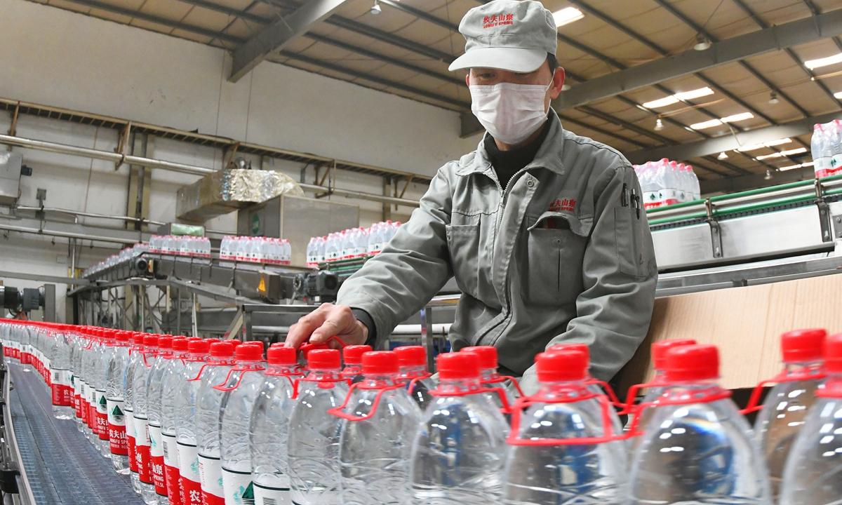 A worker in a Nongfu Spring facility in Hangzhou, East China's Zhejiang Province in February 2020 Photo: cnsphoto