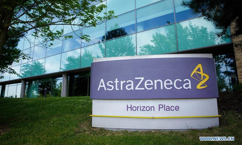 Photo taken on May 18, 2020 shows a logo in front of AstraZeneca's building in Luton, Britain. AstraZeneca, which is developing a possible vaccine against COVID-19 in partnership with the University of Oxford, on Wednesday put on hold the phase-3 trial of its vaccine following an unexplained illness in one trial participant in Britain. (Photo by Tim Ireland/Xinhua)