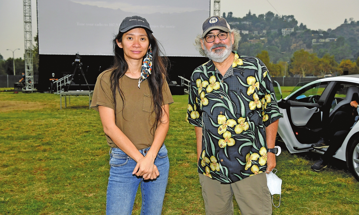 Chinese director Chloe Zhao  and Fox Searchlight Co-Chairman Stephen Gilula attend the drive-in premiere of her film <em>Nomadland</em> on Friday in Pasadena, California. Photo: AFP