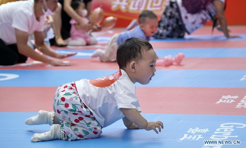 Babies participate in a baby crawling contest at a shopping center in Daxing District, Beijing, capital of China, Sept. 13, 2020. (Xinhua/Li Xin)