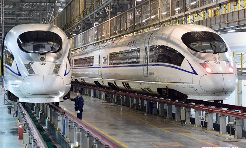 A mechanic works at a train maintenance workshop in Hefei, east China's Anhui Province, Oct. 6, 2020. Railway staff members have stepped up the maintenance of high-speed trains to ensure traffic safety as the National Day and Mid-Autumn Festival holidays are driving up travel demand. (Xinhua/Huang Bohan)
