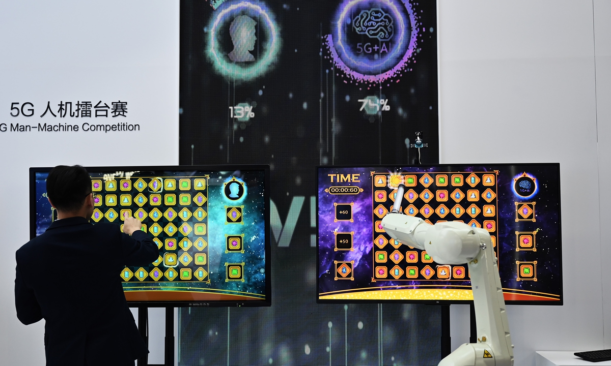 The ICT ecosystem's leading event, PT Expo China, hosted by the Ministry of Industry and Information Technology, opens on Wednesday in Beijing. Here, a man is seen competing with a 5G robot during a game at ZTE's booth. Photo: cnsphoto