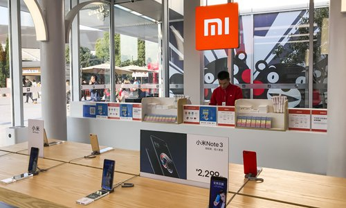 A Chinese employee at Xiaomi's Mi Home in Shanghai Photo: IC
