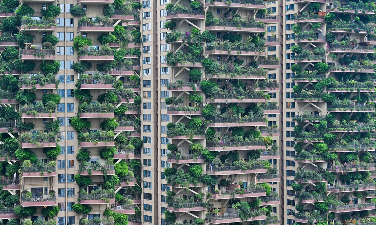 Various types of plants grow on the balconies of a 30-story residential building in Chengdu, Southwest China's Sichuan Province, giving the impression of a
